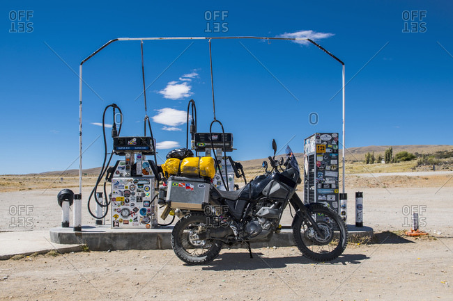El Chalten, Santa Cruz Province, Argentina - February 11, 2017: Adventure motorcycle parked at petrol station in remote area