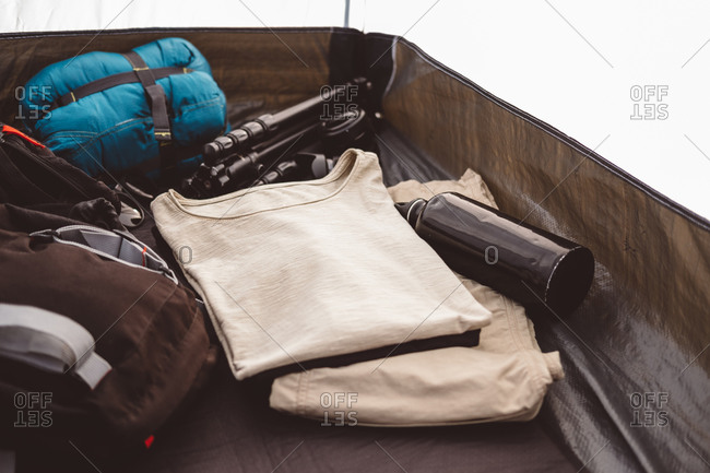Camping and trekking gear inside a tent