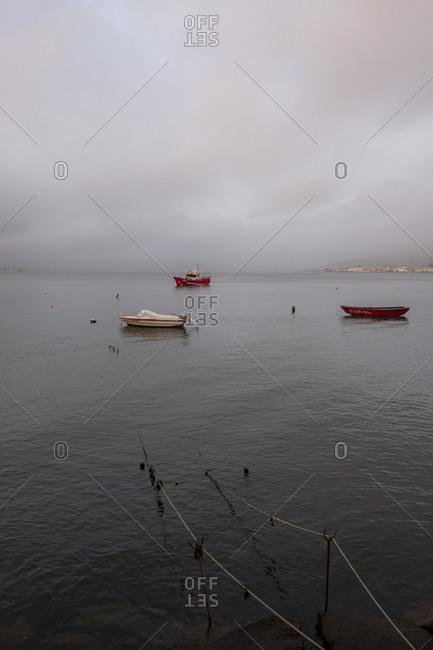 Caminha, Portugal - November 1, 2019: Boats on Rio Minho on cloudy day