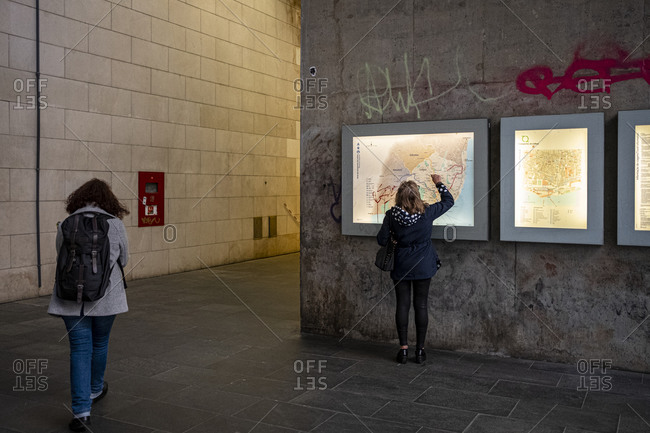 Lisbon, Portugal - November 21, 2019: Woman checking a map at Cais do Sodre metro station
