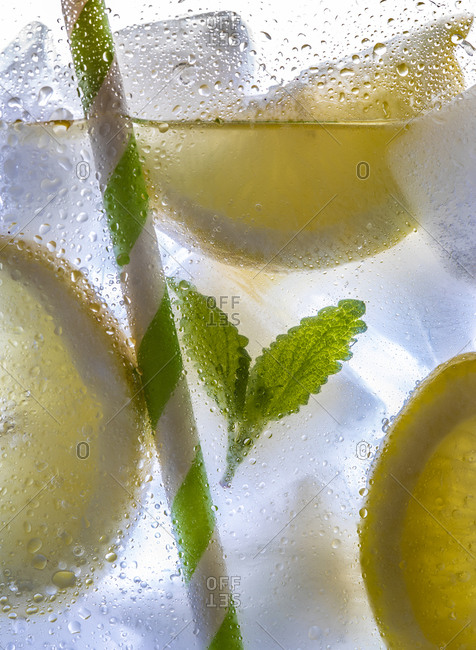 Close up of a summery cocktail with mint and lemon