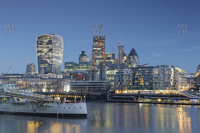 December 28, 2016:  - December 28, 2016: UK- London- skyline with office towers and HMS Belfast museum ship at dusk