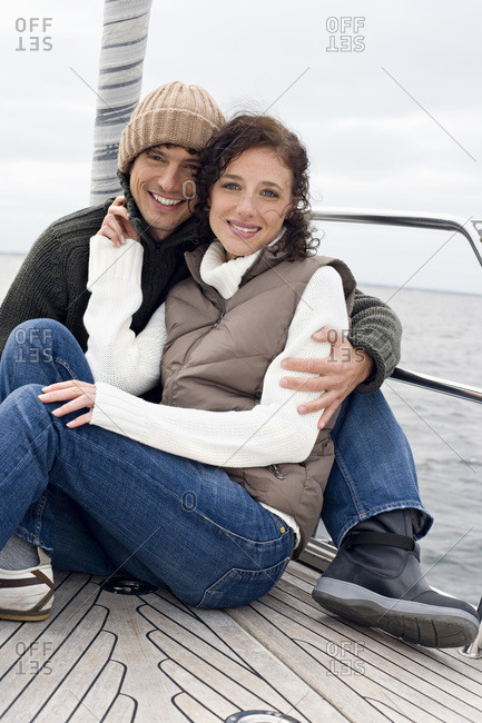 Germany- Baltic Sea- Lubecker Bucht- Young couple on sailing boat- smiling