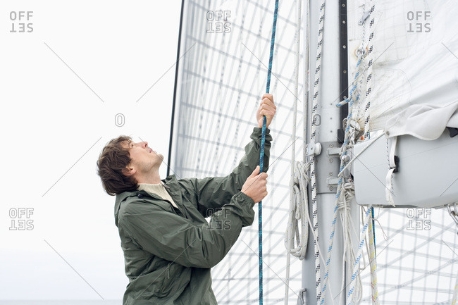 Germany- Baltic Sea- Lubecker Bucht- Young man on deck of yacht