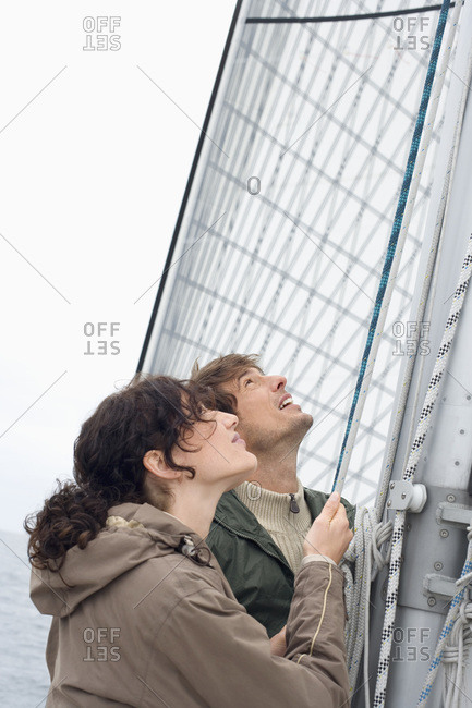 Germany- Baltic Sea- Lubecker Bucht- Young couple on yacht