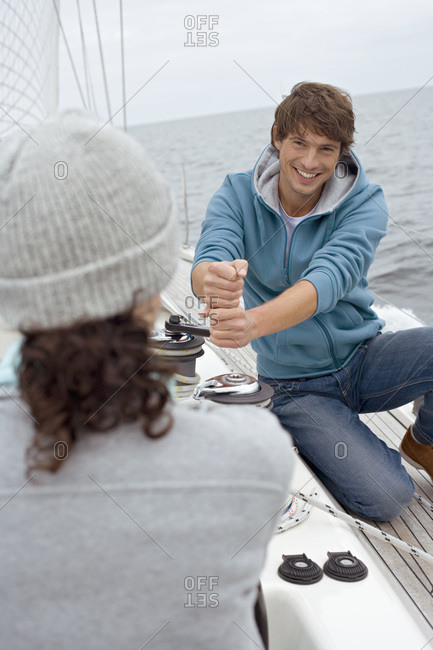 Germany- Baltic Sea- Lubecker Bucht- Young couple on sailing boat