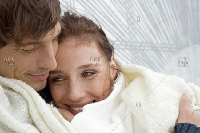 Germany- Baltic Sea- Lubecker Bucht- Young Couple embracing on yacht- smiling- portrait-