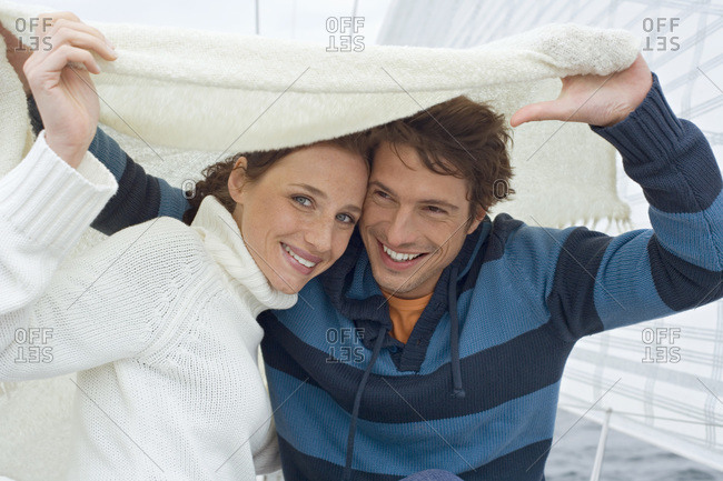 Germany- Baltic Sea- Lubecker Bucht- Young couple on sailing boat- portrait