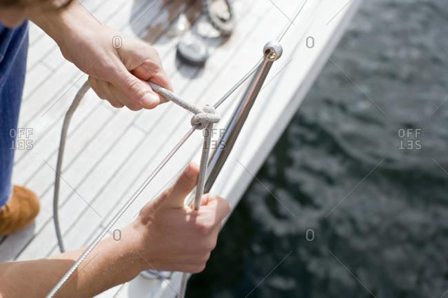 Germany- Baltic Sea- Lubecker Bucht- man tying knot