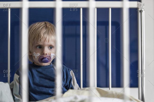 Austria- Wels-  Boy sitting on hospital bed
