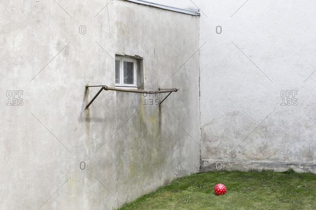 Germany- glum backyard with red ball