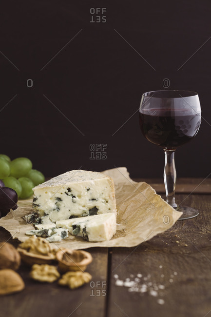 Roqufort cheese with walnuts and red wine grapes