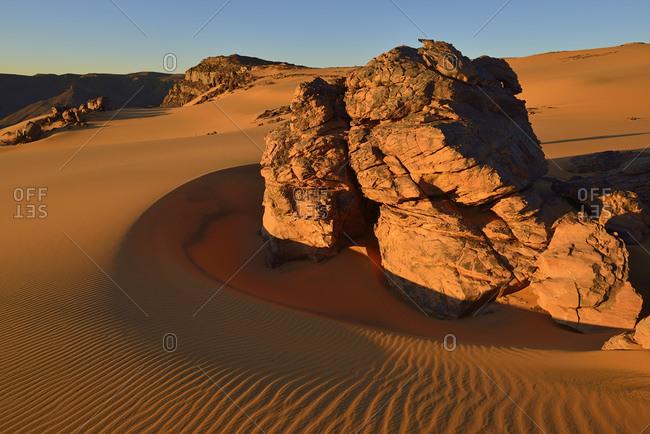 Algeria- Sahara- Tassili n'Ajjer National Park- Tadrart plateau- sand dunes and sandblasted rocks