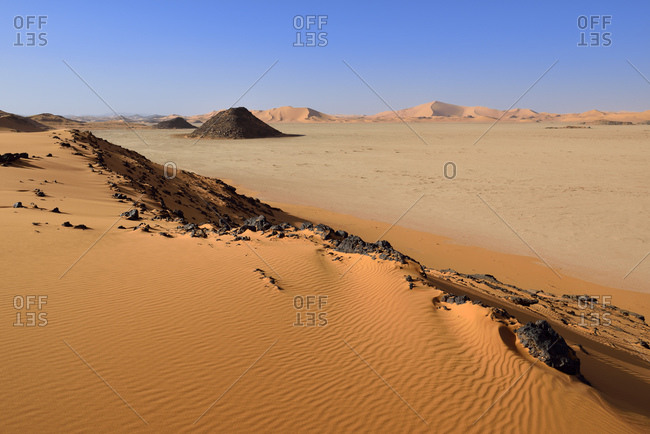 Africa- Algeria- Sahara- Tassili N'Ajjer National Park- Tadrart- Claypan and sand dunes at Oued in Djerane