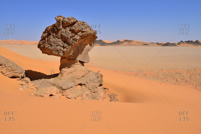 Africa- Algeria- Sahara- Tassili N'Ajjer National Park- eroded caprock at the claypan or playa of oued In Djerane- Oued In Djeran