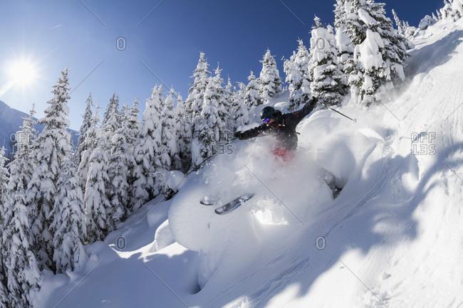 Austria- Tyrol- Mid adult man skiing in snow at Kitzbuehel