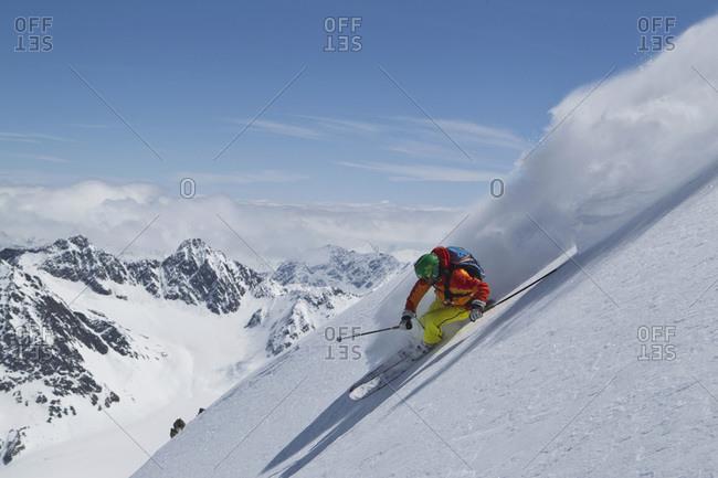 Austria- Tyrol- Mature man skiing in slope
