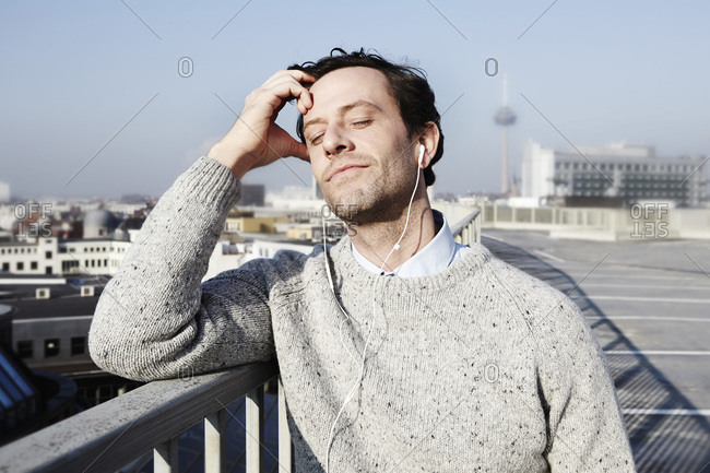 Portrait of man with closed eyes hearing music