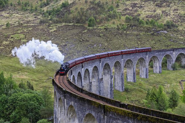 Great Britain- Scotland- Scottish Highlands- Glenfinnan- Glenfinnan Viaduct- West Highland Line- Steam engine The Jacobite