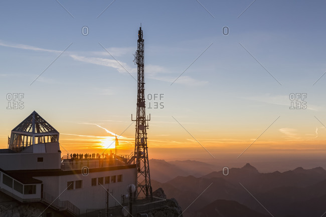 Austria- Germany- Bavaria- Zugspitze- mountain station- observation deck- aerial mast at sunset
