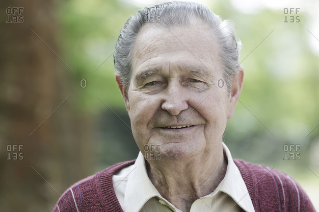 Germany- Cologne- Portrait of senior man in park- close up
