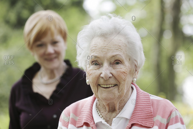 Germany- North Rhine Westphalia- Cologne- Portrait of senior woman smiling while mature woman in background