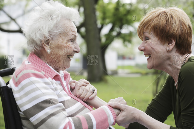 Germany- North Rhine Westphalia- Cologne- Senior woman and mature woman looking at each other- smiling