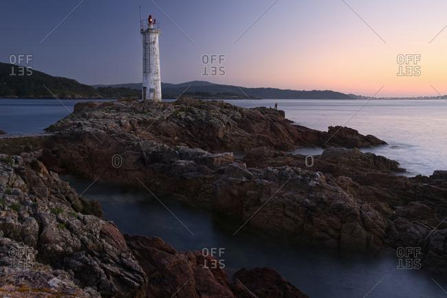 Spain- Galicia- Lighthouse at beach of Leis de Nemancos in the evening light