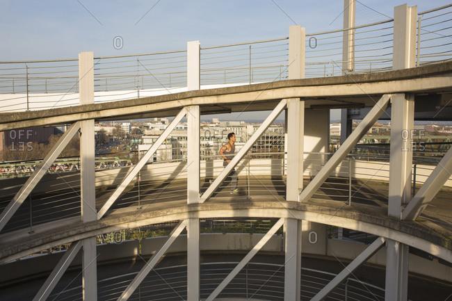 Man jogging on a ramp of a car park