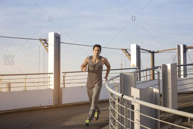 Man jogging on a ramp