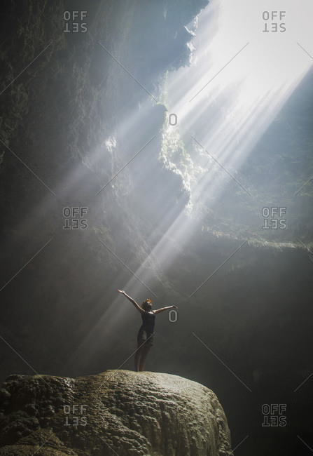 Indonesia- Young woman looking at sunbeam