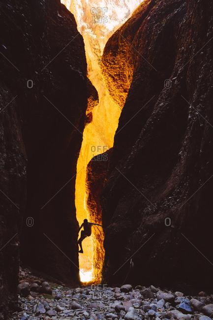 Australia- Western Australia- Kimberley- Purnululu National Park- Bungle Bungle- man climbing at Echidna Chasm