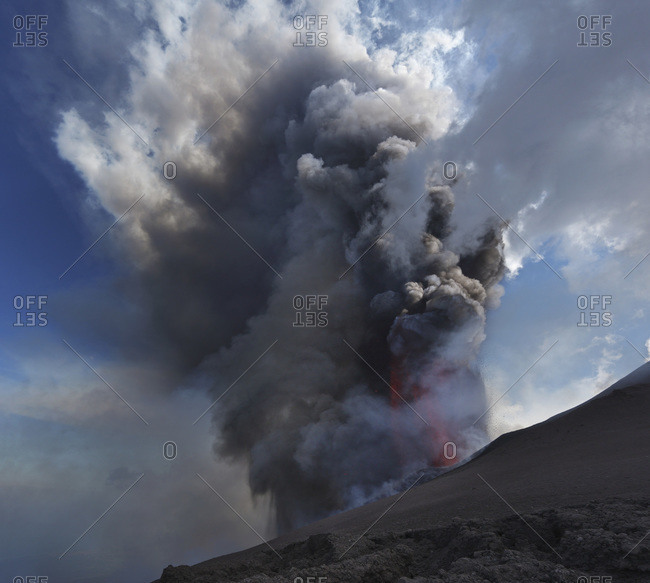 Italy- Sicily- View of lava erupting from Mount Etna