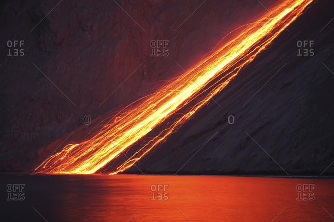 Indonesia- View of lava from Batu Tara volcano island