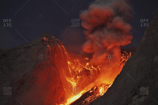 Indonesia- View of lava erupting from Batu Tara volcano island