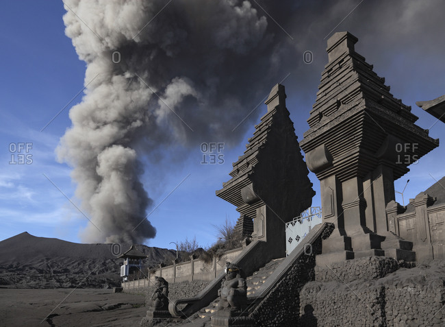 Indonesia- Java- View of eruption from Bromo volcano near temple