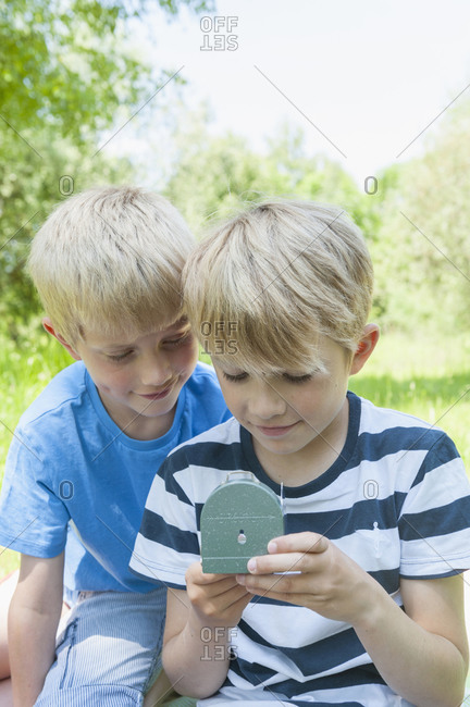 Germany- Bavaria- two boys looking at a compass