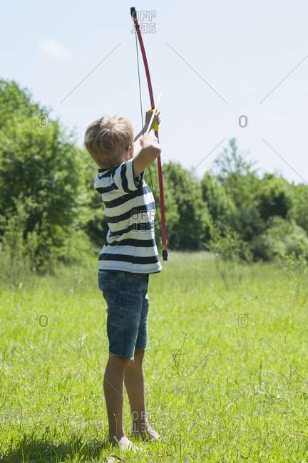 Germany- Bavaria- boy playing with bow and arrow