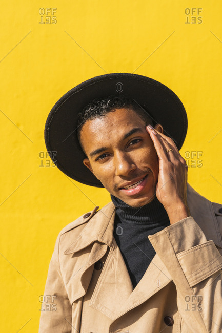 Portrait of pensive young man - wearing hat