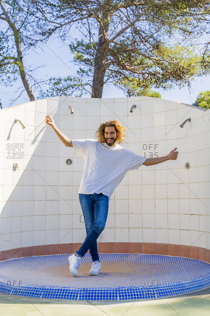 Portrait of bearded young man having fun outdoors