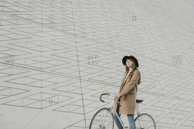 Young hipster woman on a bicycle