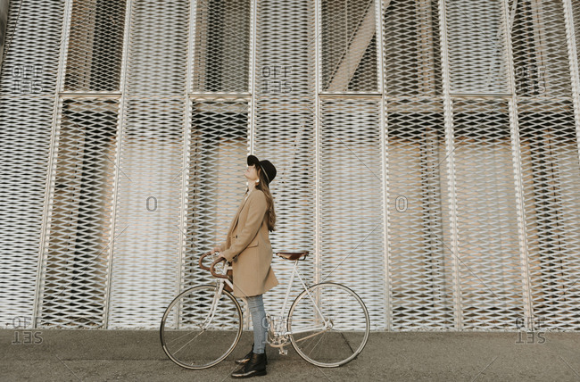 Young hipster woman with a bicycle