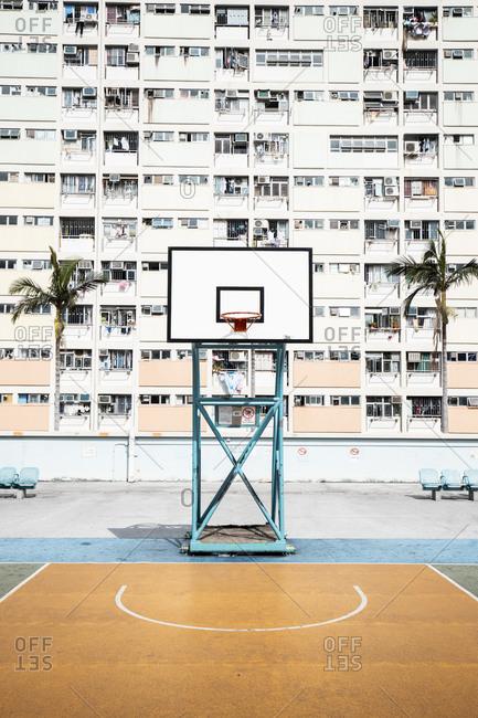 Hong Kong- Choi Hung- basketball ground in front of an apartment block