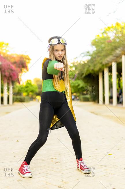 Portrait of girl posing in super heroine costume