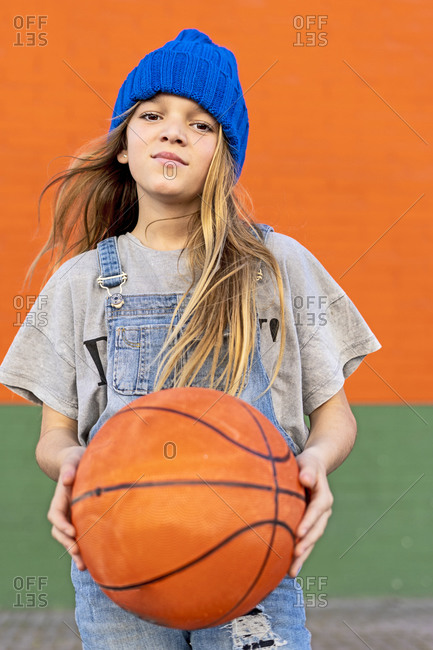 Young girl posing with a basketball