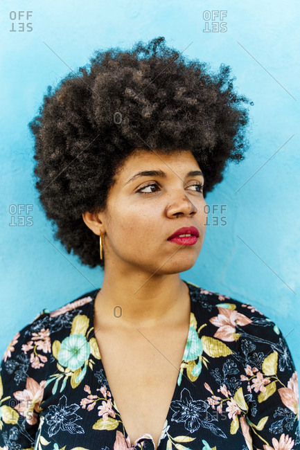 Portrait of female Afro-American woman- blue wall in the background