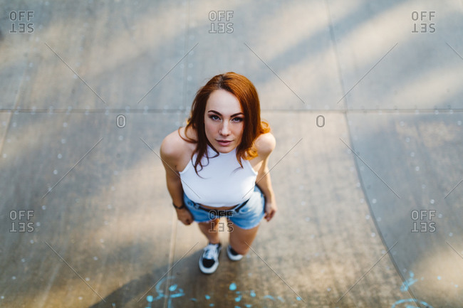 Portrait of redheaded woman looking up