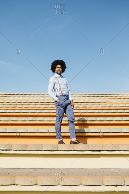 Stylish man standing on stairs