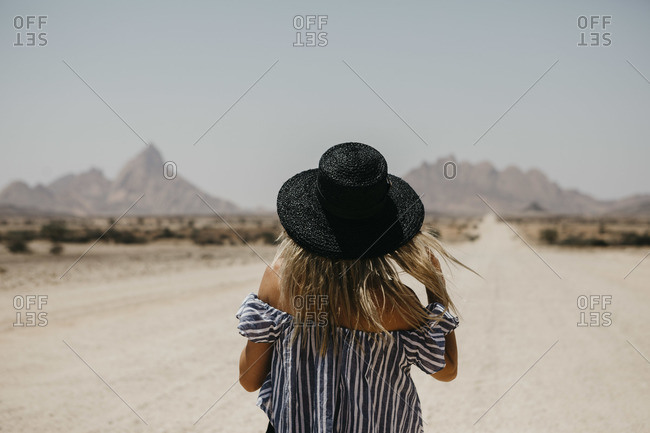 Namibia- woman wearing a hat on the road to Spitzkoppe