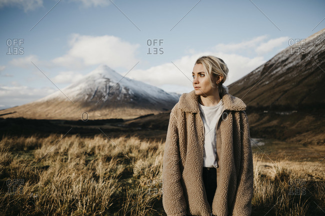UK- Scotland- Loch Lomond and the Trossachs National Park- pensive young woman standing in rural landscape